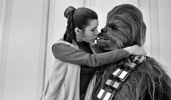 Princess Leia and Chewbacca in a tender moment onset, c. 1980